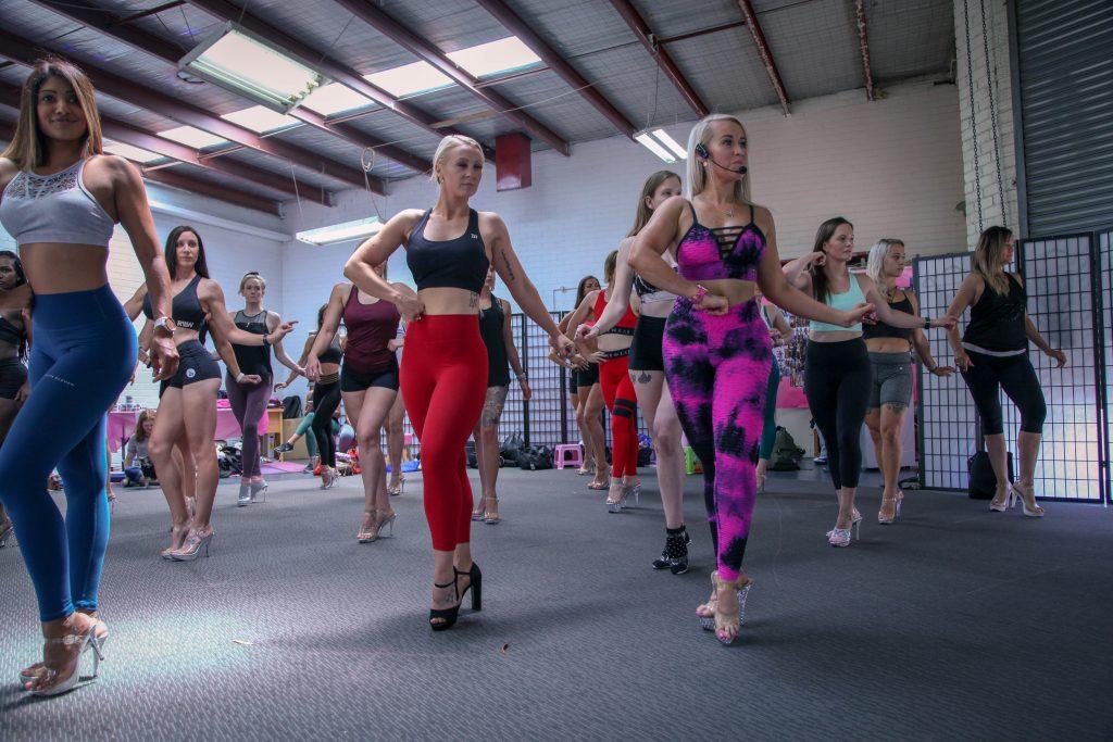Learn ICN bikini posing tips from our Posing Coaches